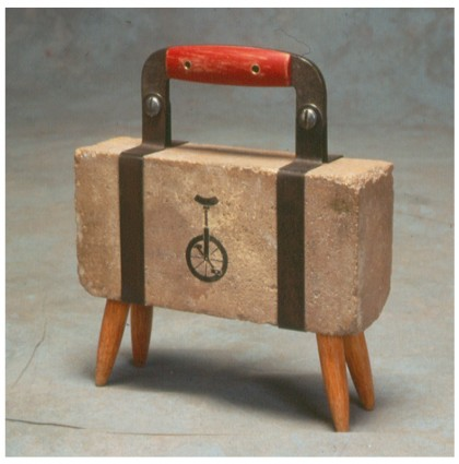 &#8220;Suitcase Radio Television Brick&#8221;<br />1995<br />Found Materials